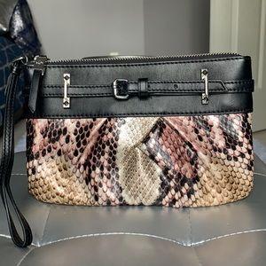 Vera Wang wristlet, free with any purchase